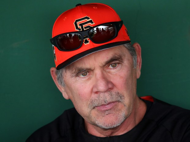 San Francisco Giants manager Bruce Bochy is photographed in the dugout at Scottsdale Stadium during Spring Training workouts on Thursday, Feb. 15, 2018, in Scottsdale, Ariz. (Aric Crabb/Bay Area News Group)