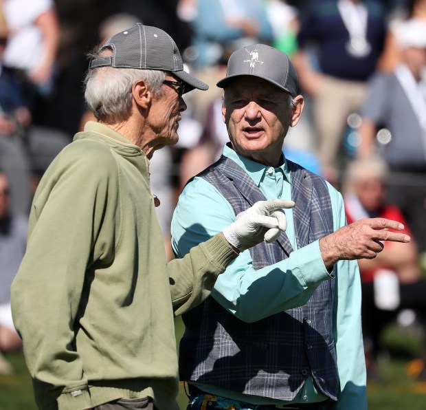 Clint Eastwood, left, talks with Bill Murray during the 3M Celebrity Challenge on Wednesday, Feb. 7, 2018, at the Pebble Beach Golf Links in Carmel, Calif. (Aric Crabb/Bay Area News Group)