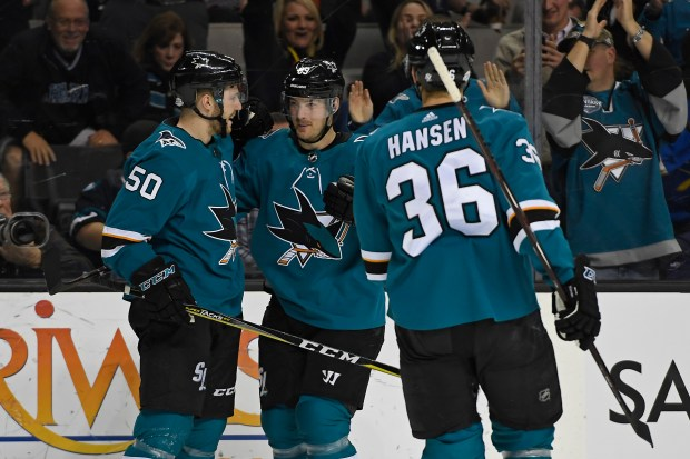 San Jose Sharks' Chris Tierney (50) congratulates teammate San Jose Sharks' Mikkel Boedker (89) after his goal against the Vancouver Canucks during the first period of their NHL game at the SAP Center in San Jose, Calif., on Thursday, Feb. 15, 2018. (Jose Carlos Fajardo/Bay Area News Group)