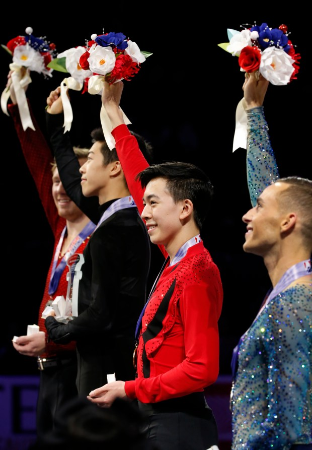 Third place winner Vincent Zhou holds up flowers on the awards stand during the US Figure Skating Championships at SAP Center on Saturday, Jan. 6, 2018, in San Jose, Calif. (Jim Gensheimer/Bay Area News Group)