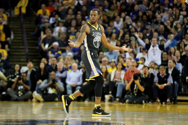 Golden State Warriors' Andre Iguodala (9) reacts after a referee called a foul against him after Oklahoma City Thunder's Russell Westbrook (0) stumbled on his drive to the hoop in the second half of an NBA game at Oracle Arena in Oakland, Calif., on Tuesday, Feb. 6, 2018. (Ray Chavez/Bay Area News Group)