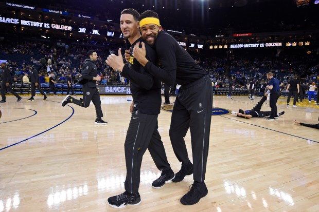Golden State Warriors' JaVale McGee (1) hugs Golden State Warriors' Klay Thompson (11) during warm ups before their NBA game against the Dallas Mavericks at the Oracle Arena in Oakland, Calif., on Thursday, Feb. 8, 2018. (Jose Carlos Fajardo/Bay Area News Group)