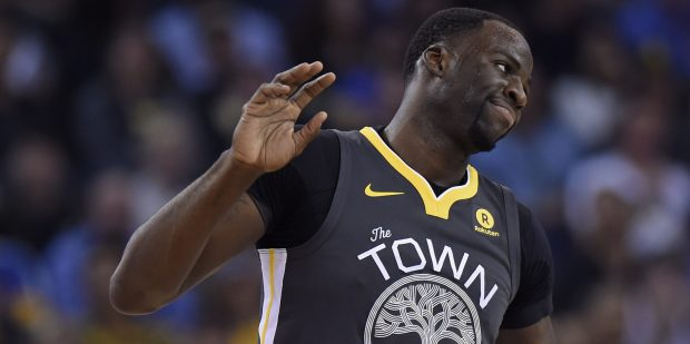 Golden State Warriors' Draymond Green (23) reacts after being called for a technical foul by an official while playing against the Dallas Mavericks during the second quarter of their NBA game at the Oracle Arena in Oakland, Calif., on Thursday, Feb. 8, 2018. (Jose Carlos Fajardo/Bay Area News Group)
