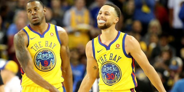 Golden State Warriors' Stephen Curry (30) and Andre Iguodala (9) celebrate a basket in the second quarter of their NBA game Oklahoma City Thunder at Oracle Arena in Oakland, Calif., on Saturday, Feb. 24, 2018. (Jane Tyska/Bay Area News Group)