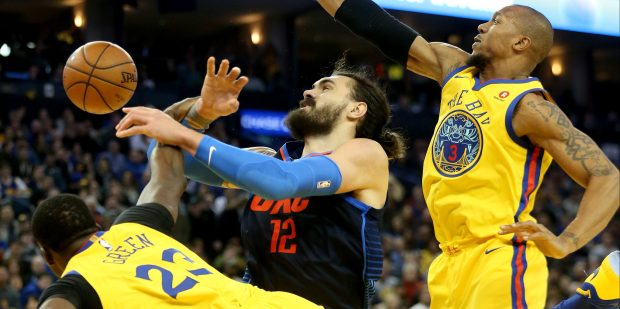 Golden State Warriors' Draymond Green (23) fouls Oklahoma City Thunder's Steven Adams (12) as Adams is double teamed by David West (3) in the fourth quarter of their NBA game at Oracle Arena in Oakland, Calif., on Saturday, Feb. 24, 2018. The Warriors won the game 112-80. (Jane Tyska/Bay Area News Group)