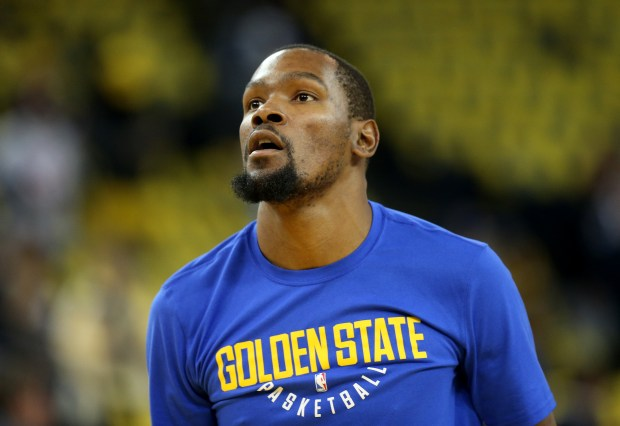 Golden State Warriors' Kevin Durant (35) warms up before their NBA game against the Oklahoma City Thunder at the Oracle Arena in Oakland, Calif., on Saturday, Feb. 24, 2018. (Jane Tyska/Bay Area News Group)