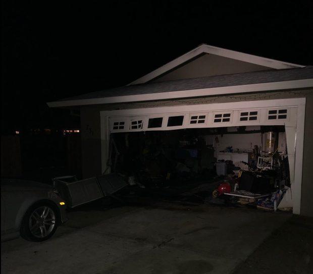 Firefighters extinguish brentwood garage fire for Brentwood garage door