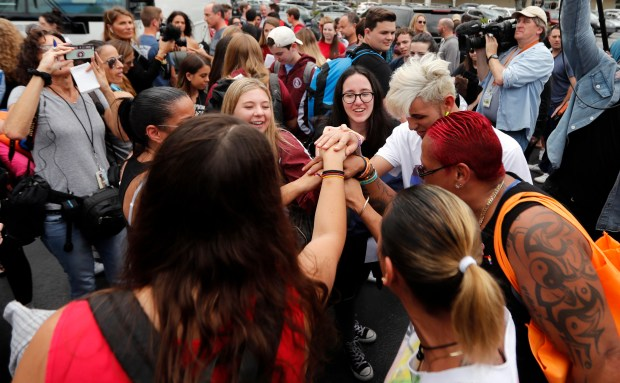 Students who survived the shooting at Stoneman Douglas High School,along with survivors of the Pulse nightclub shooting, cheer before the students board a bus in Parkland, Fla., Tuesday, Feb. 20, 2018, to rally outside the state capitol and talk to legislators about gun control reform. The students plan to hold a rally Wednesday in hopes that it will put pressure on the state's Republican-controlled Legislature to consider a sweeping package of gun-control laws, something some GOP lawmakers said Monday they would consider. (AP Photo/Gerald Herbert)