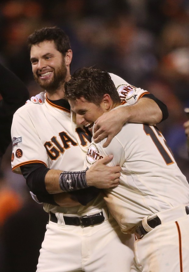 San Francisco Giants' Brandon Belt (9) celebrates with San Francisco Giants' Joe Panik (12) after winning 6-5 after hitting a double against Chicago Cubs in the 13th inning of Game 3 of the National League Division Series at AT&T Park in San Francisco, Calif., on Monday, Oct. 10, 2016. (Josie Lepe/Bay Area News Group)