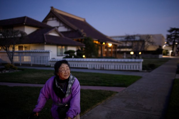 A longtime resident of Japantown, Nobuko Fujioka, 92, strolls around her neighborhood in the evening, part of her daily routine, on Jan. 30, 2018. (Dai Sugano/Bay Area News Group)