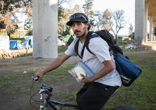 """David Martinez, 21, poses for a portrait at the homeless encampment where he lives off Felipe Avenue next to the 101 and 280 freeways in San Jose, California, on Saturday, February 3, 2018. CalTrans recently notified residents of San Jose's largest homeless encampment since the """"Jungle"""" that it will evict them with a massive sweep on Monday morning, February 5. (LiPo Ching/Bay Area News Group)"""