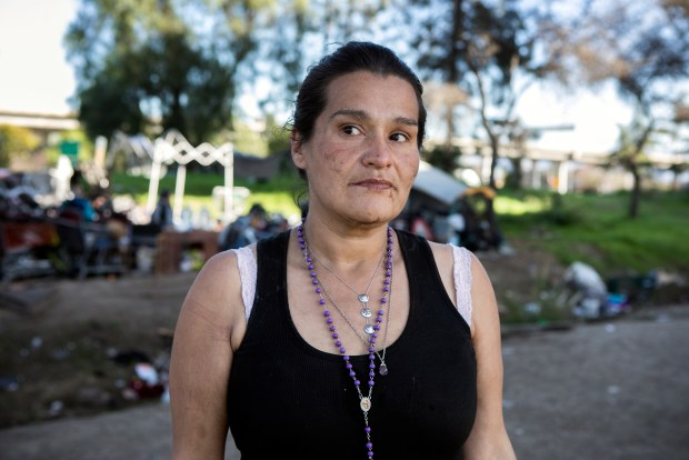 """Jacquline Bojorquez, 39, poses for a portrait at the homeless encampment where she lives off Felipe Avenue next to the 101 and 280 freeways in San Jose, California, on Saturday, February 3, 2018. CalTrans recently notified residents of San Jose's largest homeless encampment since the """"Jungle"""" that it will evict them with a massive sweep on Monday morning, February 5. (LiPo Ching/Bay Area News Group)"""