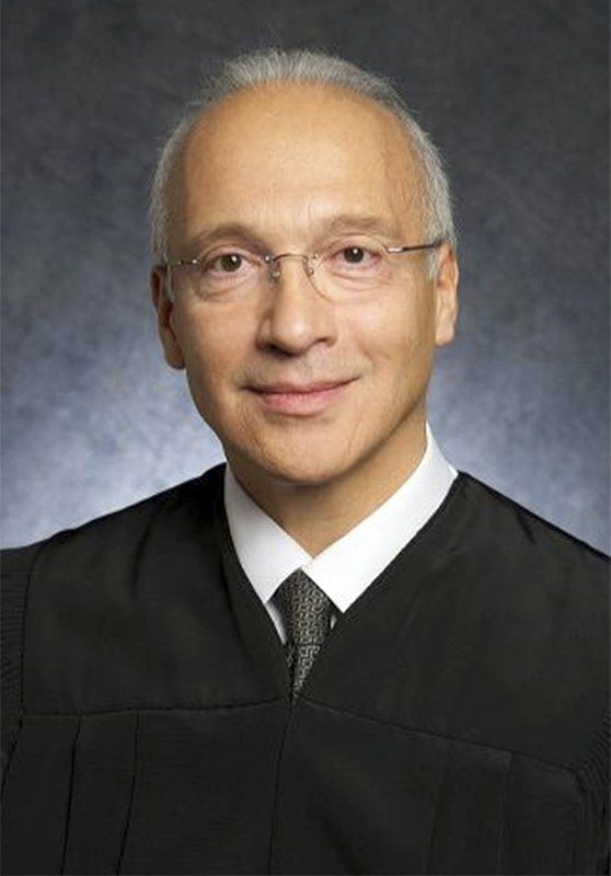 This undated file photo provided by the U.S. District Court shows Federal Judge Gonzalo Curiel. Curiel was berated by Donald Trump for his handling of lawsuits alleging fraud at now-defunct Trump University. He will hear arguments Friday, Feb. 9, 2018, in a lawsuit that could block construction of a border wall with Mexico, or at least cause major delays. (U.S. District Court via AP, File)