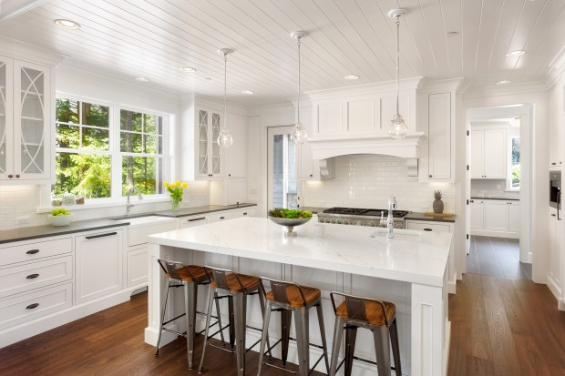 The white-on-white kitchens remain popular but homeowners are bringing in another color with their kitchen islands.