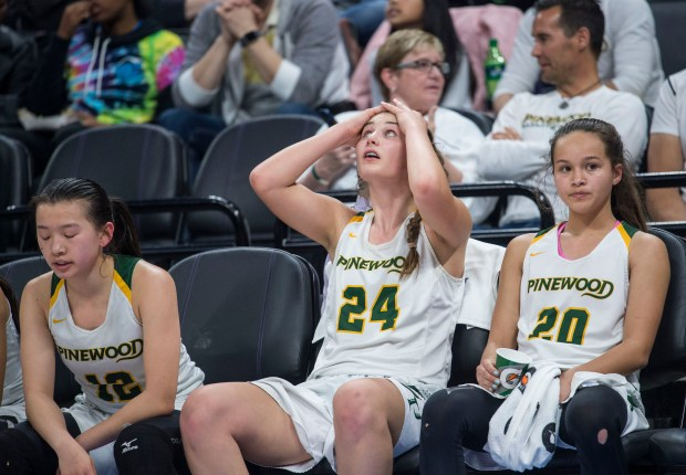 Pinewood High School guard Kaitlyn Leung (12) of Los Altos and teammates Hannah Jump (24) and Courtni Thompson (20) react to their team's 58-47 loss against Windward High School of Los Angeles during the CIF Girls open Division Championship at the Golden 1 Center in Sacramento, Calif., on Saturday, March 24, 2018. (photo by Hector Amezcua)