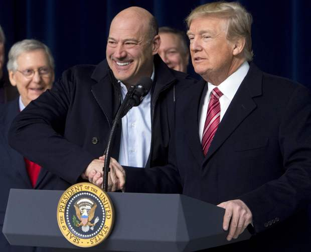 """(FILES) In this file photo taken on January 6, 2018 US President Donald Trump shakes hands with Gary Cohn, Director of the National Economic Council, during a retreat with Republican lawmakers and members of his Cabinet at Camp David in Thurmont, Maryland.Donald Trump's White House was rocked by another high-profile resignation March 6, 2018, as top economic advisor Gary Cohn quit in protest at the president's decision to levy global steel tariffs. """"It has been an honor to serve my country and enact pro-growth economic policies to benefit the American people,"""" Cohn said in a terse statement that belied fierce infighting in Trump's tumultuous White House. / AFP PHOTO / SAUL LOEBSAUL LOEB/AFP/Getty Images"""