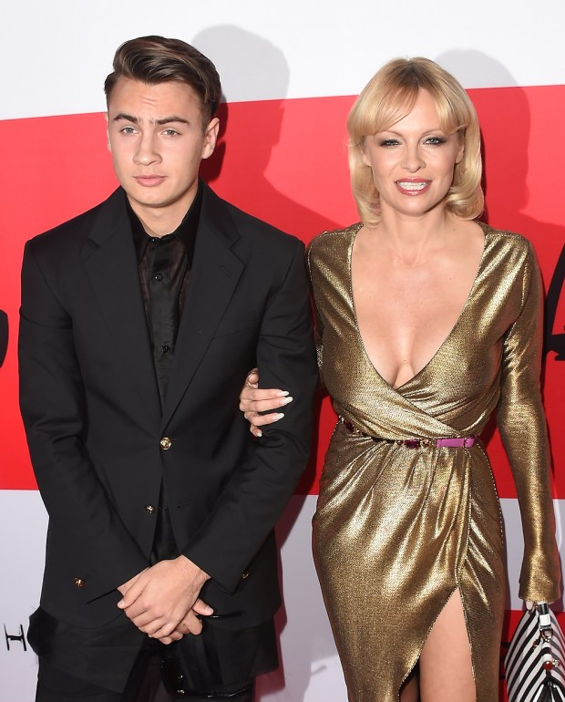Actress Pamela Anderson and her son Brandon Thomas Lee pose during the premiere of Open Road Films' 'The Gunman' at Regal Cinemas L.A. Live on March 12, 2015 in Los Angeles, California. (Photo by Jason Merritt/Getty Images)