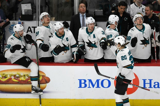 San Jose Sharks' Marcus Sorensen (20) of Sweden, celebrates with teammates on the bench after scoring a goal during the first period of an NHL hockey game against the Chicago Blackhawks Monday, March 26, 2018, in Chicago. (AP Photo/Paul Beaty)