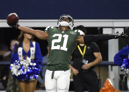 New York Jets free safety Marcus Gilchrist (21) celebrates intercepting a pass from Dallas Cowboys quarterback Kellen Moore in the first half of an NFL football game, Saturday, Dec. 19, 2015, in Arlington, Texas. (AP Photo/Michael Ainsworth)