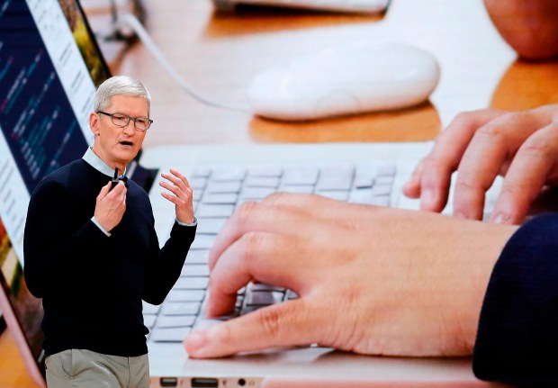 Apple CEO Tim Cook speaks at Lane Tech College Prep High School in Chicago,Illionos on March 27, 2018. (JIM YOUNG/AFP/Getty Images)