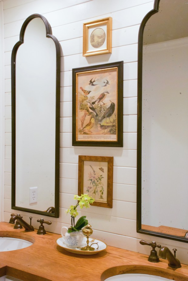 Hanging artwork between two vanity mirrors can give your bathroom an added pop. (Mary Carol Garrity/TNS)