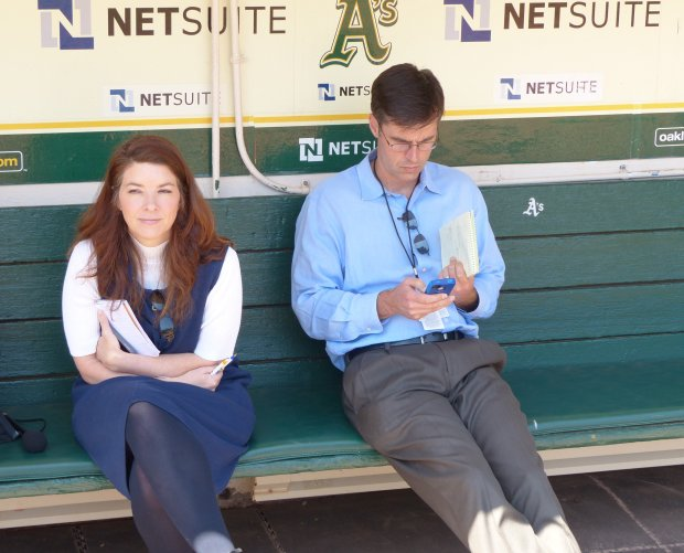 Husband-and-wife rivals Daniel Brown and Susan Slusser get their game-faceson at the Oakland Coliseum.