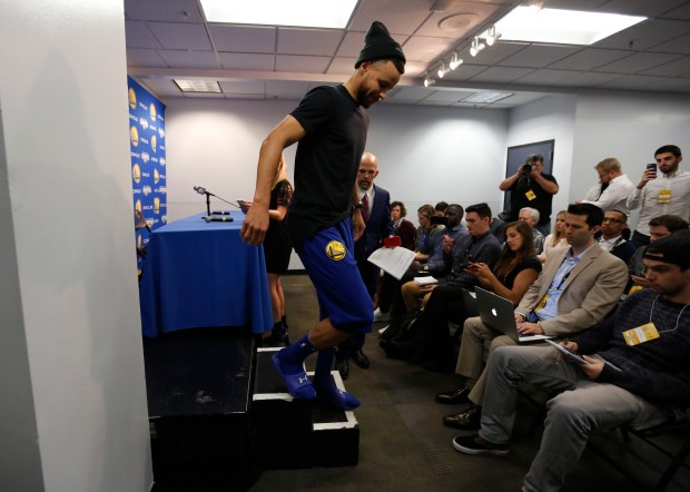 Golden State Warriors' Stephen Curry (30) leaves a press conference before the Warriors game against the Utah Jazz at Oracle Arena in Oakland, Calif., on Sunday, March 25, 2018. (Nhat V. Meyer/Bay Area News Group)