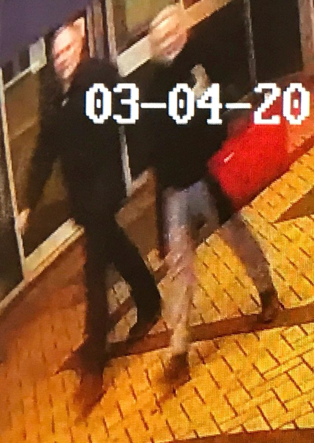 This image taken from security camera footageshows a man and woman as they walk through an alleyway connecting  Zizzi's restaurant to a bench where  former Russian double agent Sergei Skripal was found in Salisbury on Sunday March 4, 2018  The image is believed to be of interest to police. (AP Photo)