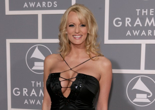 FILE - In this Feb. 11, 2007, file photo, adult film actress Stormy Daniels arrives for the 49th Annual Grammy Awards in Los Angeles. CBS News President David Rhodes says there's more journalistic work to be done before an interview with Daniels is aired. Daniels has alleged an extramarital affair with Trump before he became president, which he has denied. (AP Photo/Matt Sayles, File)