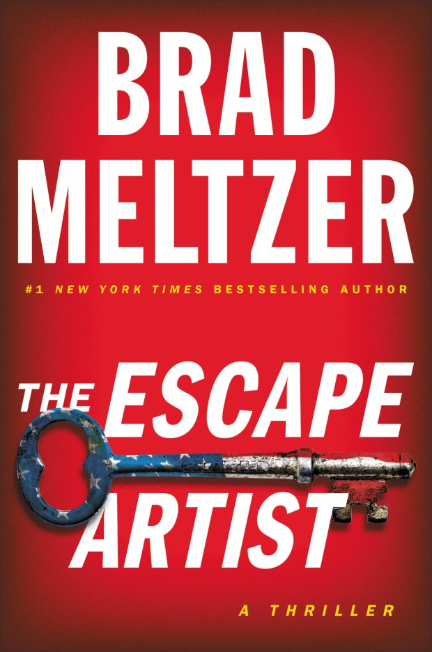 "This cover image released by Grand Central Publishing shows ""The Escape Artist,"" a thriller by Brad Meltzer. (Grand Central Publishing via AP)"