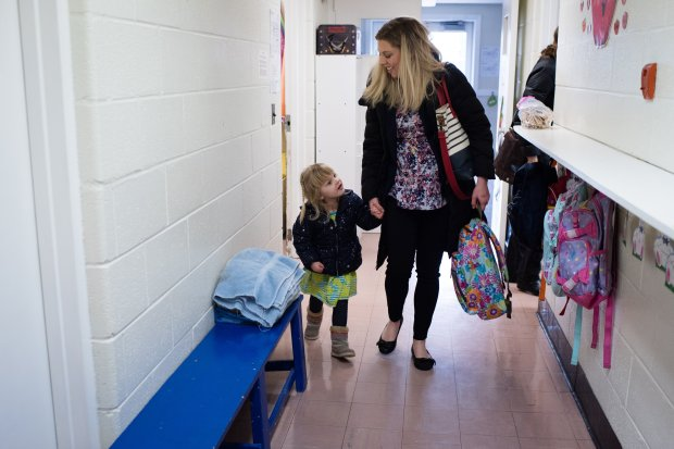 Salli Garrigan, 35, picks up her daughter, Dottie Garrigan, 3, from schoolin Alexandria, Va. MUST CREDIT: Washington Post photo by Sarah L. Voisin