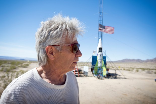 """FILE - In this March 6, 2018, file photo, """"Mad"""" Mike Hughes reacts after the decision to scrub another launch attempt of his rocket near Amboy, Calif. The self-taught rocket scientist who believes the Earth is flat propelled himself about 1,000 feet into the air before a hard-landing in the Mojave Desert that left him injured Saturday, March 24, 2018. Hughes tells The Associated Press that he injured his back but is otherwise fine after Saturday's launch near Amboy, Calif. (James Quigg/Daily Press via AP, File)"""