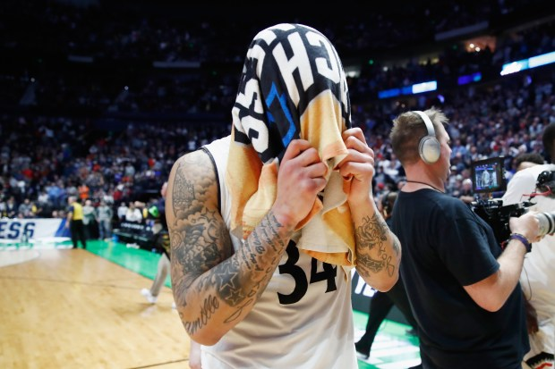 NASHVILLE, TN - MARCH 18: Jarron Cumberland #34 of the Cincinnati Bearcats reacts after falling to the Nevada Wolf Pack during the second half in the second round of the 2018 Men's NCAA Basketball Tournament at Bridgestone Arena on March 18, 2018 in Nashville, Tennessee. (Photo by Andy Lyons/Getty Images)