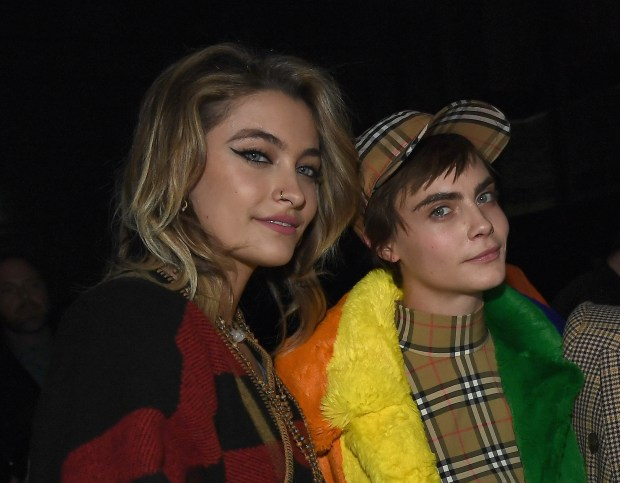 Paris Jackson and Cara Delevingne at the Burberry February 2018 show during London Fashion Week at Dimco Buildings on February 17, 2018 in London, England. (Photo by Gareth Cattermole/Getty Images for Burberry)