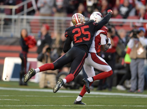 Arizona Cardinals' J.J. Nelson (14) makes a catch against San Francisco 49ers' Jimmie Ward (25) in the fourth quarter of their NFL game at Levi's Stadium in Santa Clara, Calif., on Sunday, Nov. 29, 2015. (Dan Honda/Bay Area News Group)