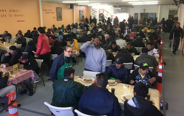 More than 100 people eat breakfast at Desayunador Padre Chava, a soup kitchen in Tijuana, Mexico that serves deportees from the U.S. on Feb. 27, 2018. (Casey Tolan/Bay Area News Group)