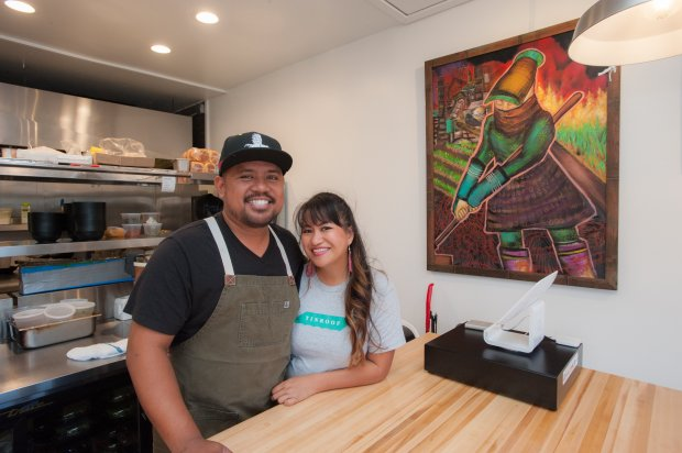 """Top Chef"" alum Sheldon Simeon and his wife, Janice, inside their newrestaurant, Tin Roof, near the airport in Kahului, Maui. (Mieko Horikoshi/Tin Roof)"