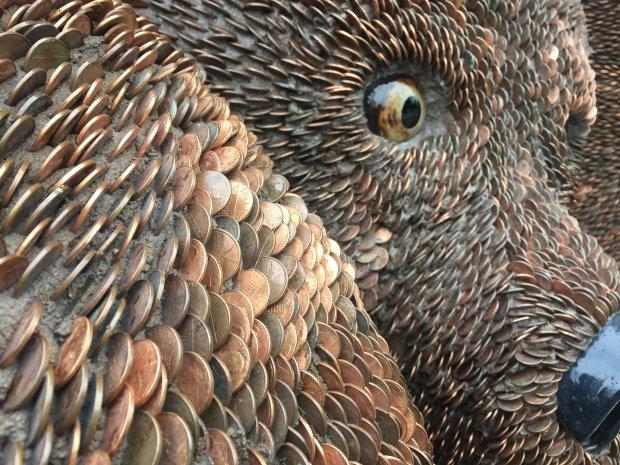 """""""Ursa Mater,"""" by the art team Mr and Mrs Ferguson, has a """"fur coat"""" createdwith 200,000 pennies. (Sal Pizarro/Bay Area News Group)"""