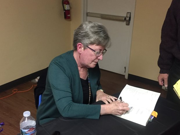 """Mary Jo Ignoffo signs her Sarah Winchester biography, """"Captive of theLabyrinth,"""" following a reading at the historic Fallon House in downtown San Jose on Wednesday, March 14, 2018. (Sal Pizarro/Bay Area News Group)"""