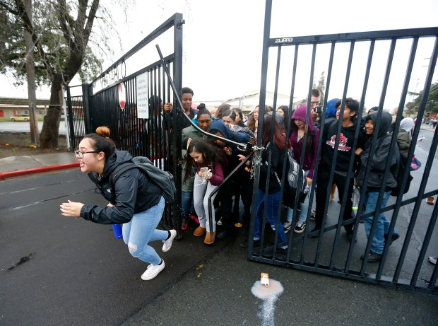 Students from Mount Diablo High School break through a gate to leave campus during a walkout to protest gun violence on Wednesday, March 14, 2018, in Concord, Calif (Aric Crabb/Bay Area News Group)