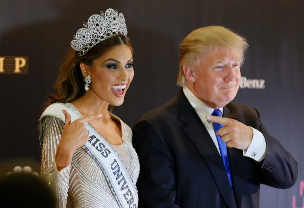 Miss Universe 2013 Gabriela Isler, from Venezuela, left, and pageant owner Donald Trump, of the United States, point to each other while posing for a photo after the 2013 Miss Universe pageant in Moscow, Russia, on Saturday, Nov. 9, 2013. (AP Photo/Ivan Sekretarev)
