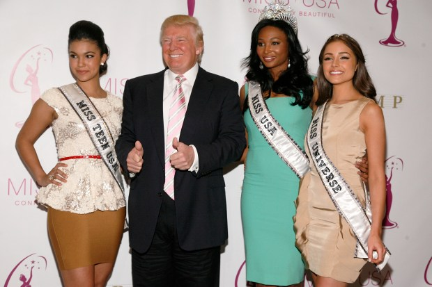 NEW YORK, NY - JANUARY 09: (L to R) Miss Teen USA Logan West, Donald Trump, Miss USA Nana Meriwether and Miss Universe Olivia Culpo attend the crowning ceremony of the new Miss USA at Trump Tower on January 9, 2013 in New York City. (Photo by Andy Kropa/Getty Images)