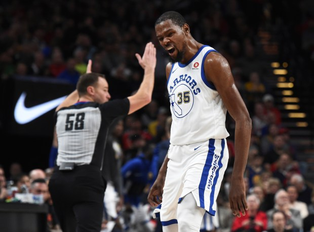 Golden State Warriors forward Kevin Durant reacts after hitting a shot to give the Golden State Warriors a lead during the second half of an NBA basketball game against the Portland Trail Blazers in Portland, Ore., Friday, March 9, 2018. The Blazers won 125-108. (AP Photo/Steve Dykes)