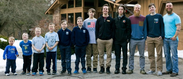 Brothers Francisco, 2, Tucker, 4, Luke, 6, Charlie, 8, Gabe, 11, Wesley, 9, Calvin, 13, Drew, 20, Tommy, 16, Zach, 22, Vinny, 15, and Ty Schwandt, 25. The only brother not pictured is Brandon, 18. (Casey Sykes /The Grand Rapids Press via AP)