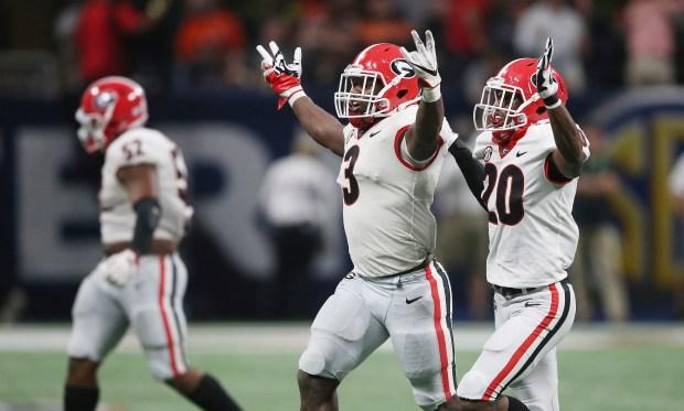 Georgia linebacker Roquan Smith (3) celebrates a Georgia turnover against Auburn during the second half of the Southeastern Conference championship NCAA college football game, Saturday, Dec. 2, 2017, in Atlanta. (AP Photo/John Bazemore)