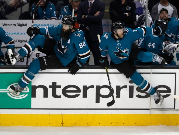 San Jose Sharks' Brent Burns (88) and San Jose Sharks' Paul Martin (7) head onto the ice during their game against the Colorado Avalanche in the second period at the SAP Center in San Jose, Calif., on Thursday, April 5, 2018. (Nhat V. Meyer/Bay Area News Group)