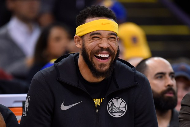 Golden State Warriors' JaVale McGee (1) reacts after teammate Nick Young (6) makes a three-point basket against the Phoenix Suns during the third quarter of their NBA game at the Oracle Arena in Oakland, Calif., on Monday, Feb. 12, 2018. (Jose Carlos Fajardo/Bay Area News Group)