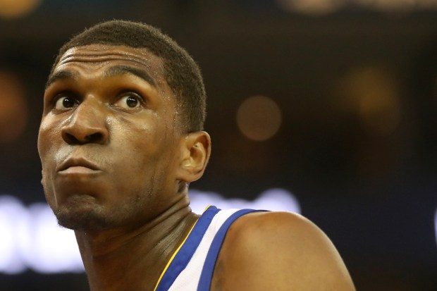 Golden State Warriors' Kevon Looney (5) looks around after he was fouled on his drive to the hoop against the Indiana Pacers in the first half of an NBA game at Oracle Arena in Oakland, Calif., on Tuesday, March 27, 2018. (Ray Chavez/Bay Area News Group)