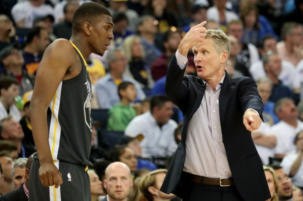 Golden State Warriors head coach Steve Kerr gives instructions to Kevon Looney (5) in the second half of an NBA game against the New Orleans Pelicans at Oracle Arena in Oakland, Calif., on Saturday, April 7, 2018. (Ray Chavez/Bay Area News Group)