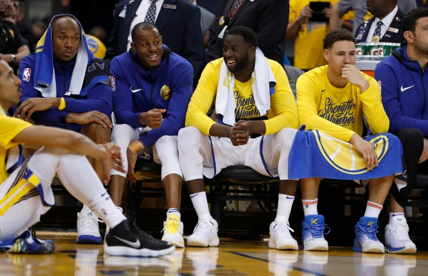 Golden State Warriors' Andre Iguodala (9) and Golden State Warriors' Draymond Green (23) talk on the bench towards the end of the fourth quarter of Game 1 of their NBA first-round playoff series against the San Antonio Spurs at the Oracle Arena in Oakland, Calif., on Saturday, April 14, 2018. (Nhat V. Meyer/Bay Area News Group)